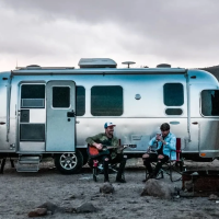 Two men in front of an Airstream