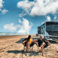 Couple and RV on beach