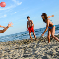 People playing ball on the beach