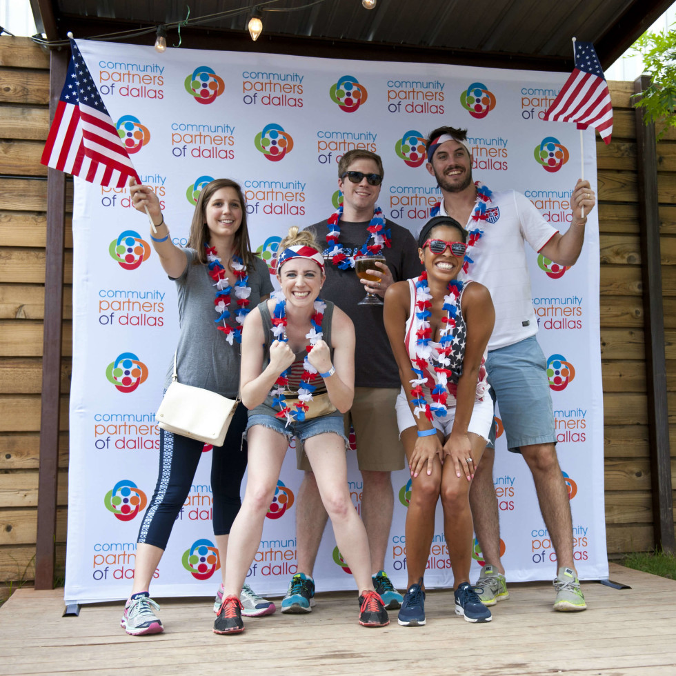 """Team """"Bald Eagles"""" at """"Selfie Station"""" – (front) – Jennifer Yank and Jill Gragg; (Back) – Anne Tabb, Andrew Von Kerens, and Shep Robinson"""
