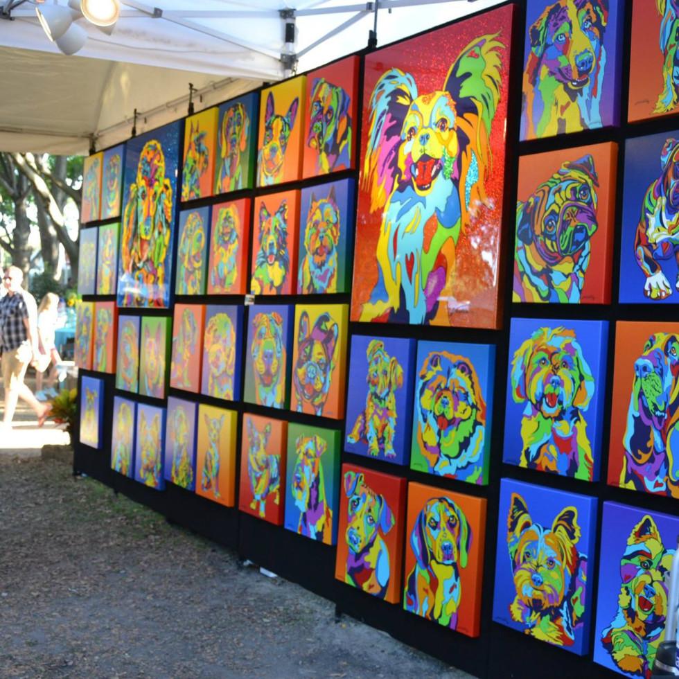 Row of dog paintings