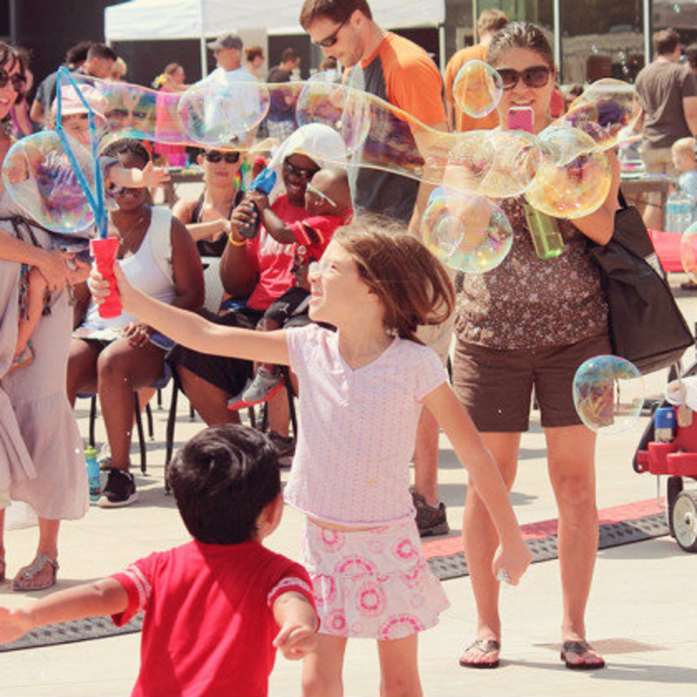 kids playing at Bubblepalooza at the long Center