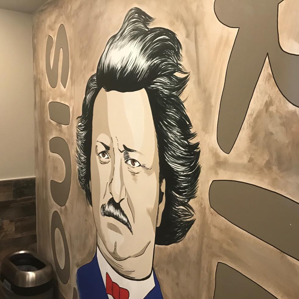 Riel restaurant men's bathroom mural