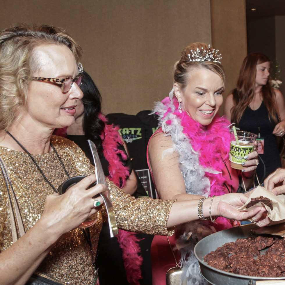 Becky McAndrews, Joan Cohe, Adrienne Brown-Franklin samle cat shit cookies at Sweet Potato Queens party