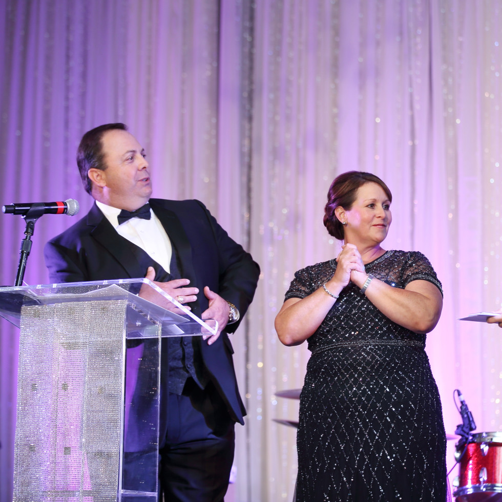 Big Brothers Big Sisters gala 2015 Event Chairs Matt and Manon Kebodeaux with CEO Pierce Bush