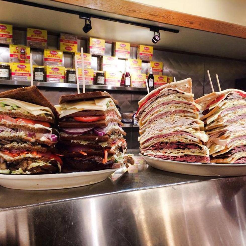 Kenny & Ziggy's giant deli sandwiches on counter