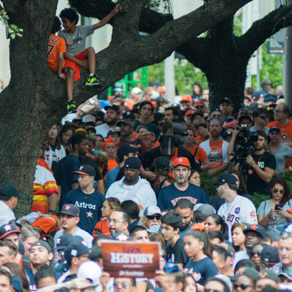 Astros World Series victory parade and rally, boys in tree
