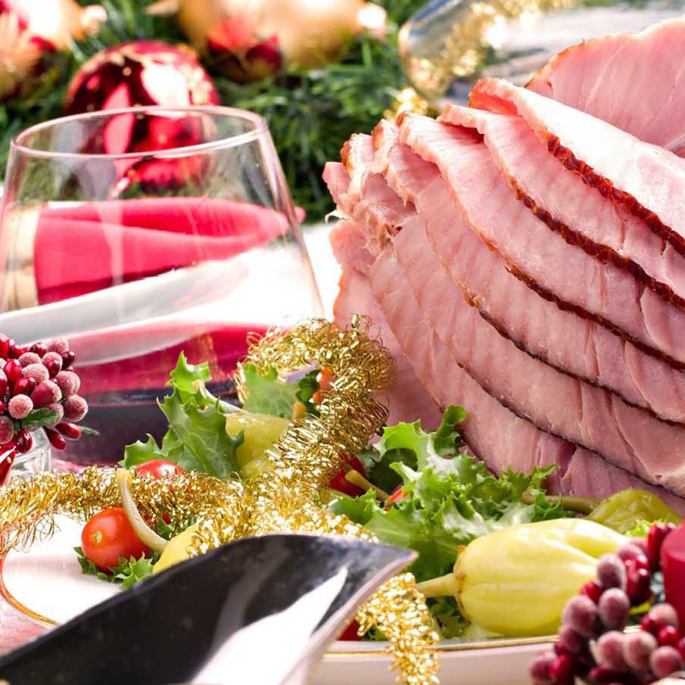 Christmas dinner with ham and red wine and candles