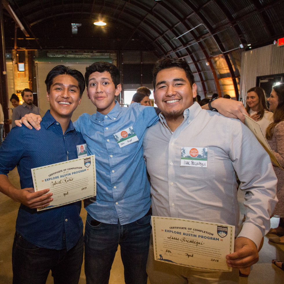 Explore Austin Graduating Explorers Gabriel R., Pedro R., and Issac P. PC Andy Sams.jpg