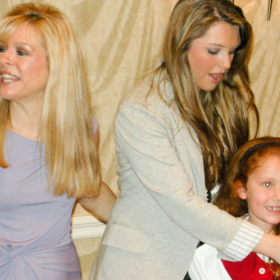 News_Blind Side luncheon_March 2010_Leigh Anne Tuohy_Collins Tuohy_Louisa Sarofim