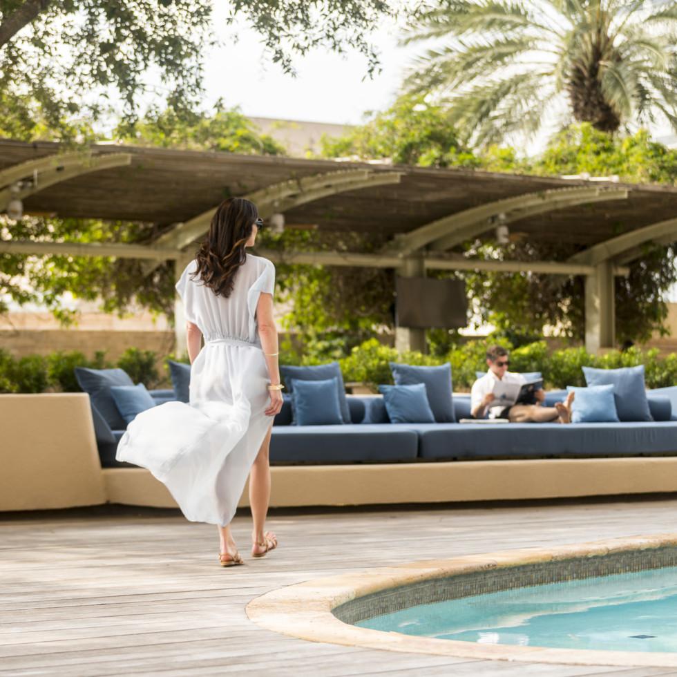 Four Seasons Houston pool woman walking spa