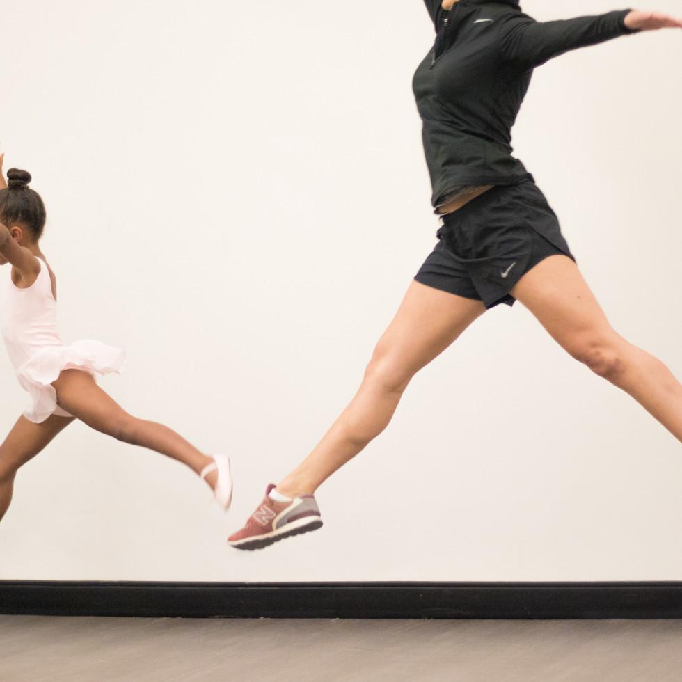 Little girl and woman dancing ballet