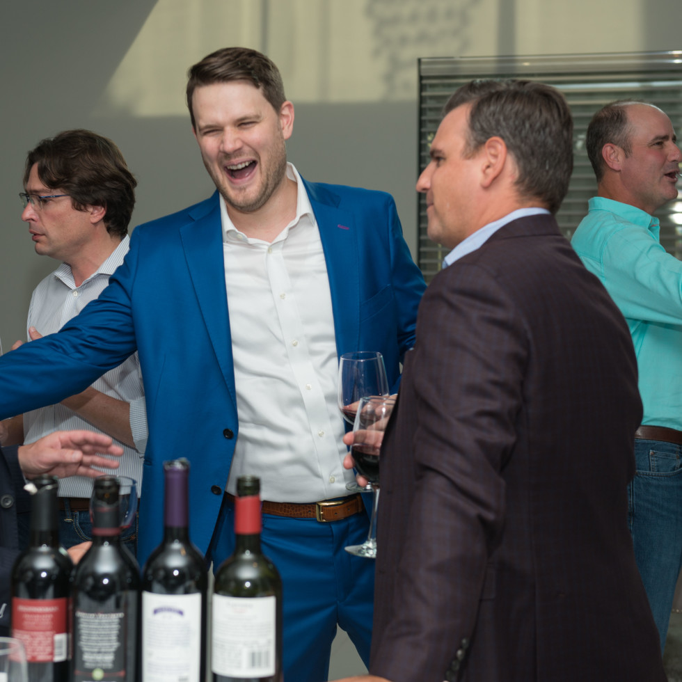 Men laughing at a party