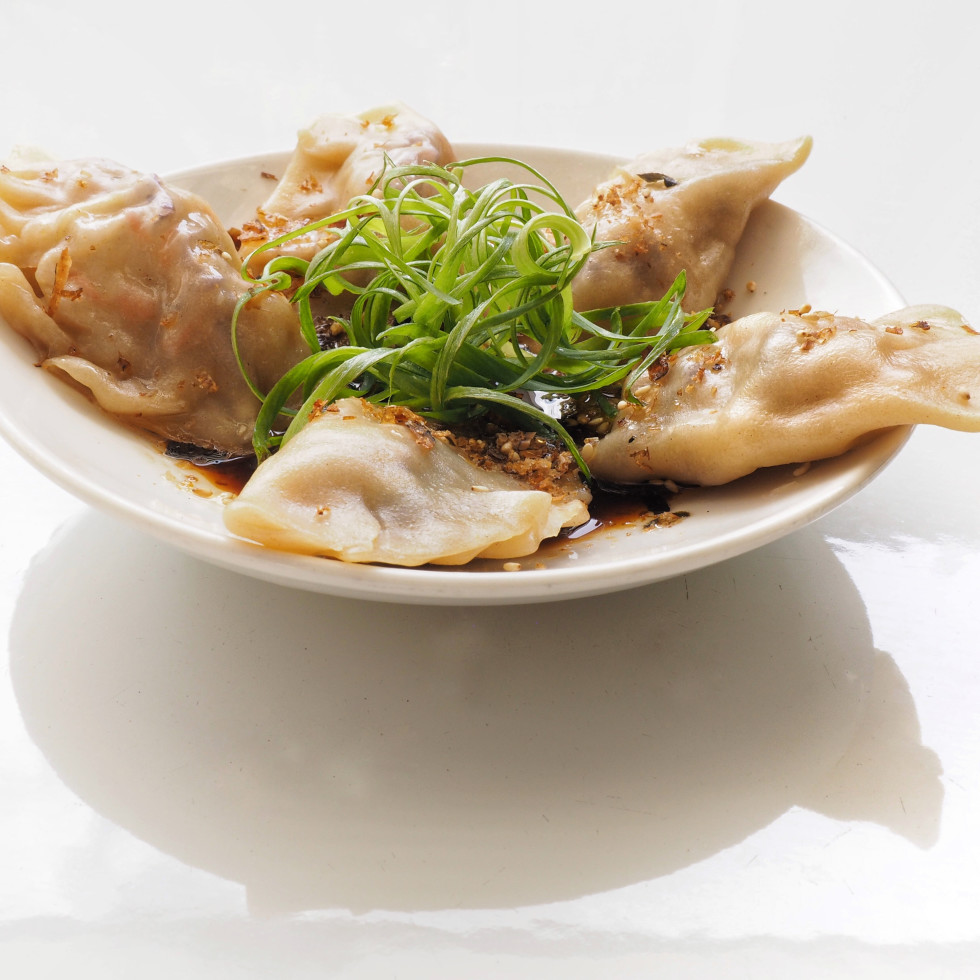 Veggie dumplings with ponzo and chili oil