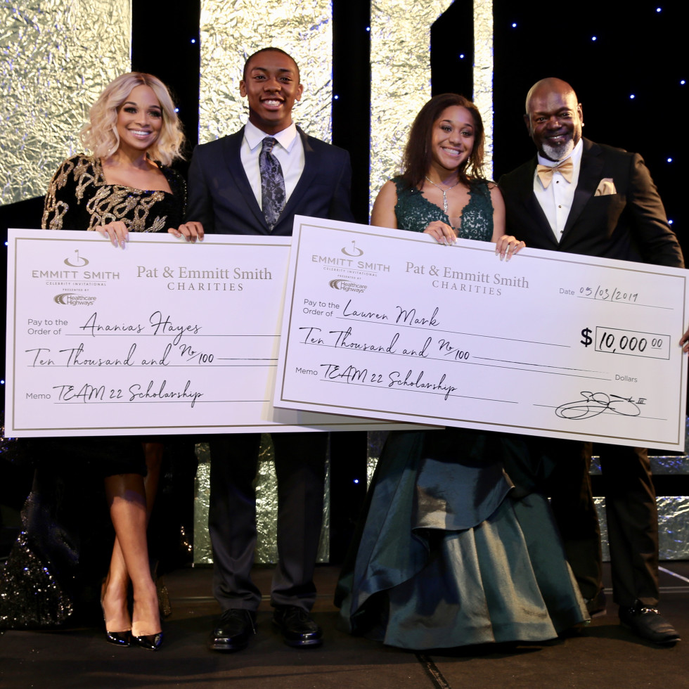 Ananias Hayes and Lauren Marks receive scholarships from Pat and Emmitt Smith.