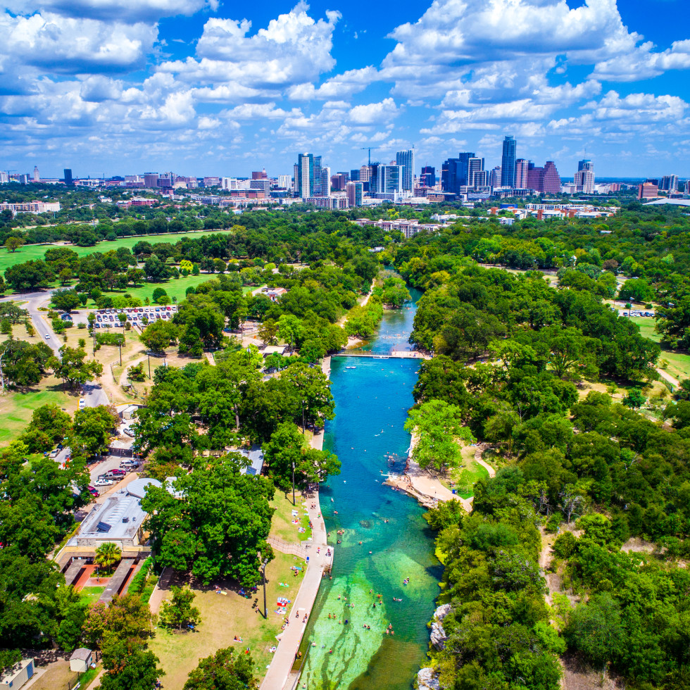 Austin skyline with Barton Springs Pool and Lady Bird Lake