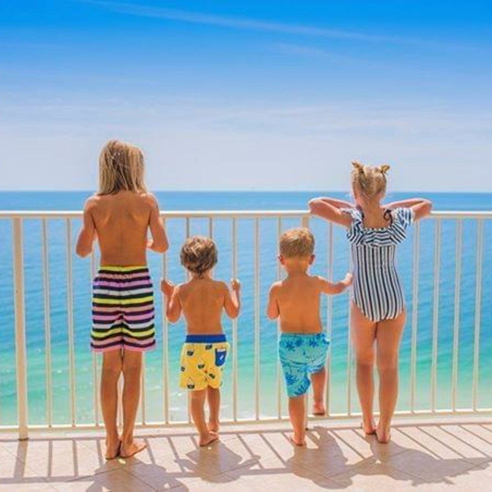 Kids looking out onto the ocean