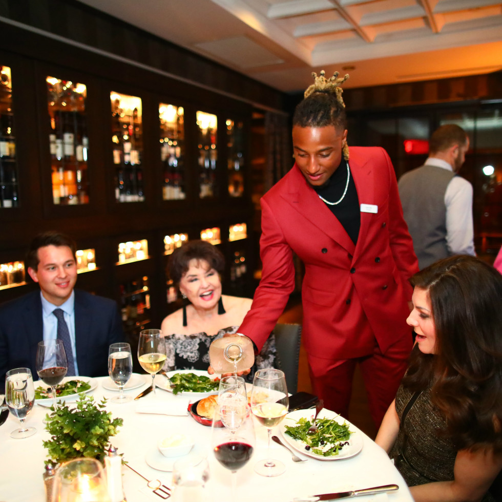 Houston Texans Champions for Youth Dinner Justin Reid serving