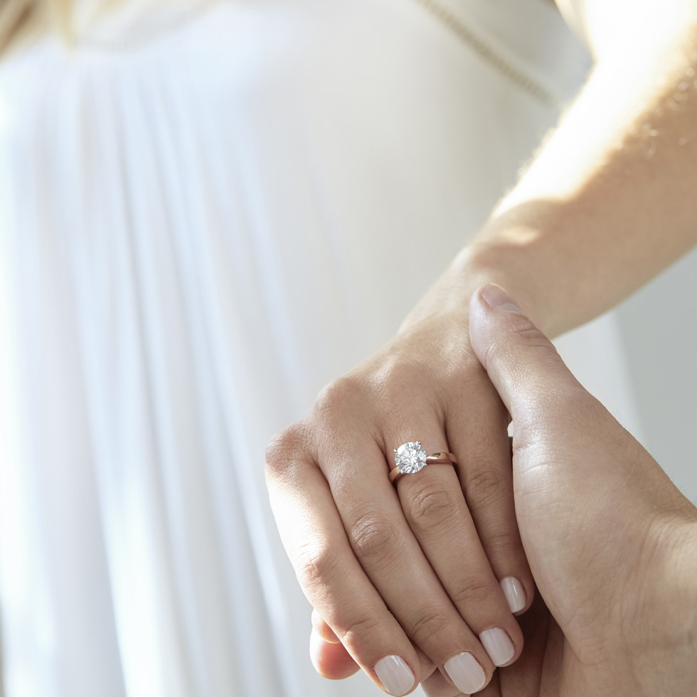 Woman showing off engagement ring