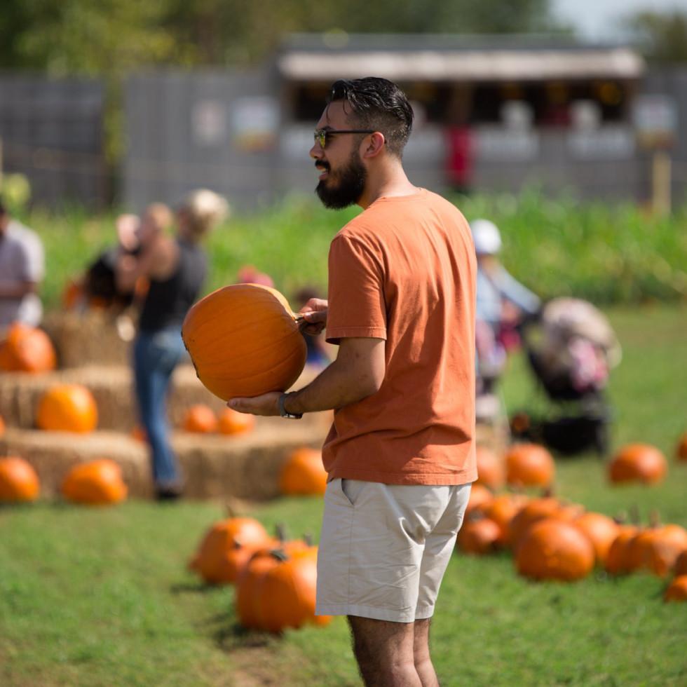 Barton Hills Farms pumpkin patch man with pumpkin