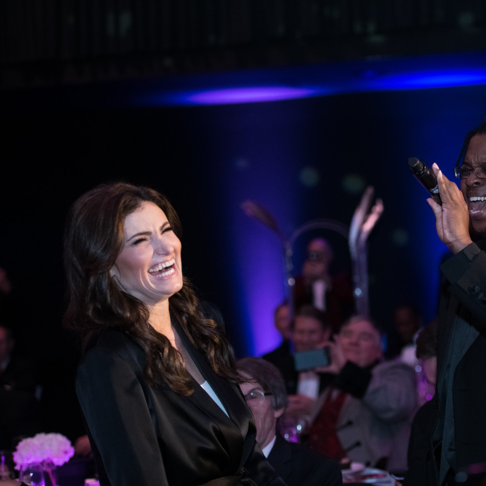 Idina Menzel singing with TCC member Gregory Perry.