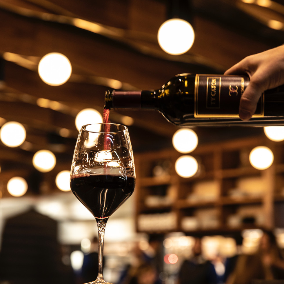 Georgia James wine pouring