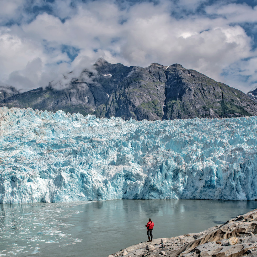 Person looking at a glacier