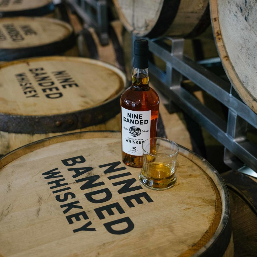 Nine Banded Whiskey on barrels