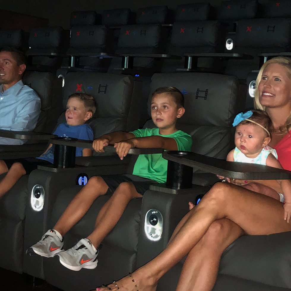 Strike + Reel movie theater with family