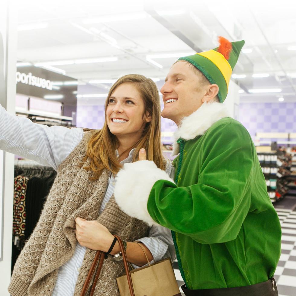 Elf posing with shopper for selfie
