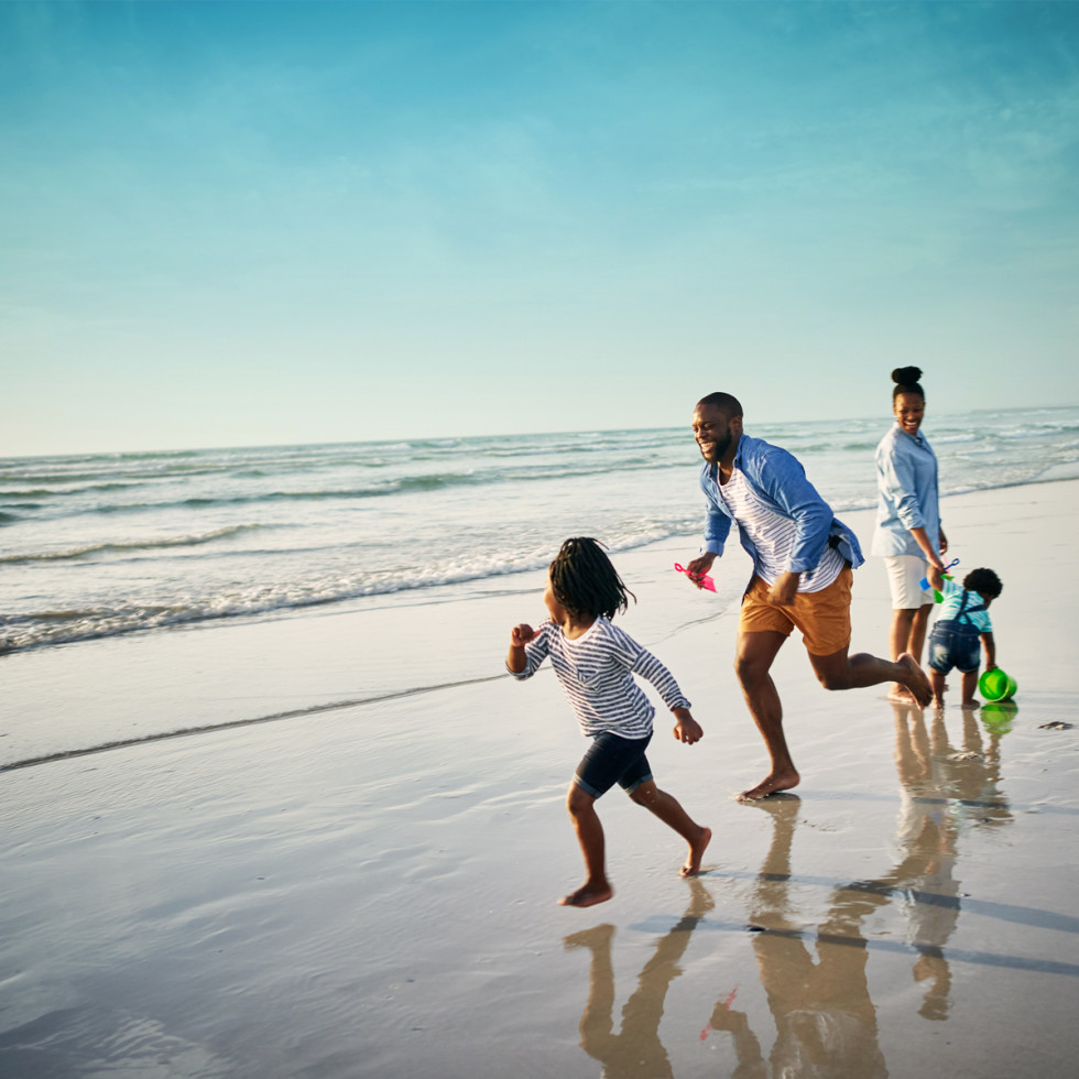 Family running on the beach at South Padre Island