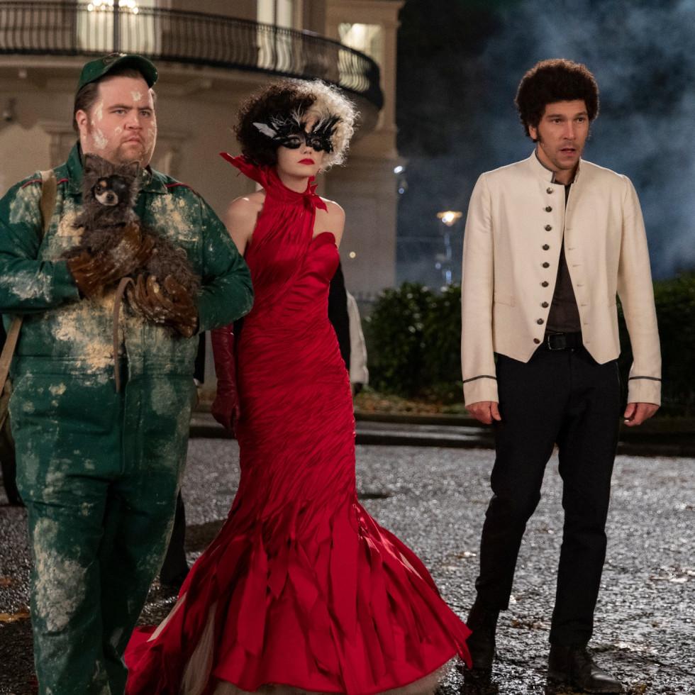 Paul Walter Hauser, Emma Stone, and Joel Fry in Cruella