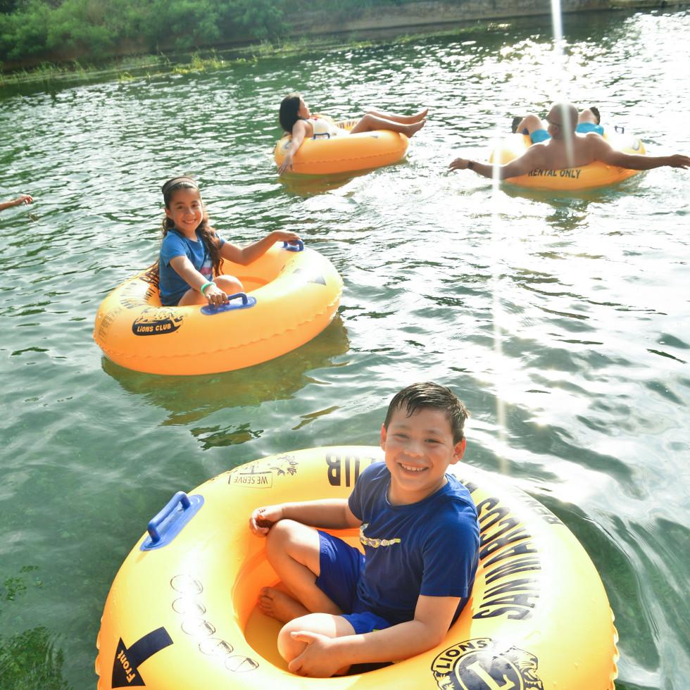 Kids in inner tubes on San Marcos River