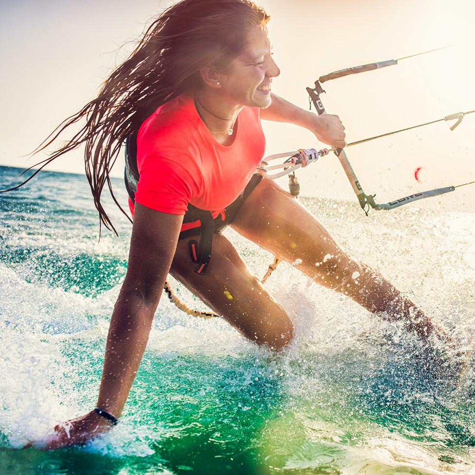 Woman kite boarding