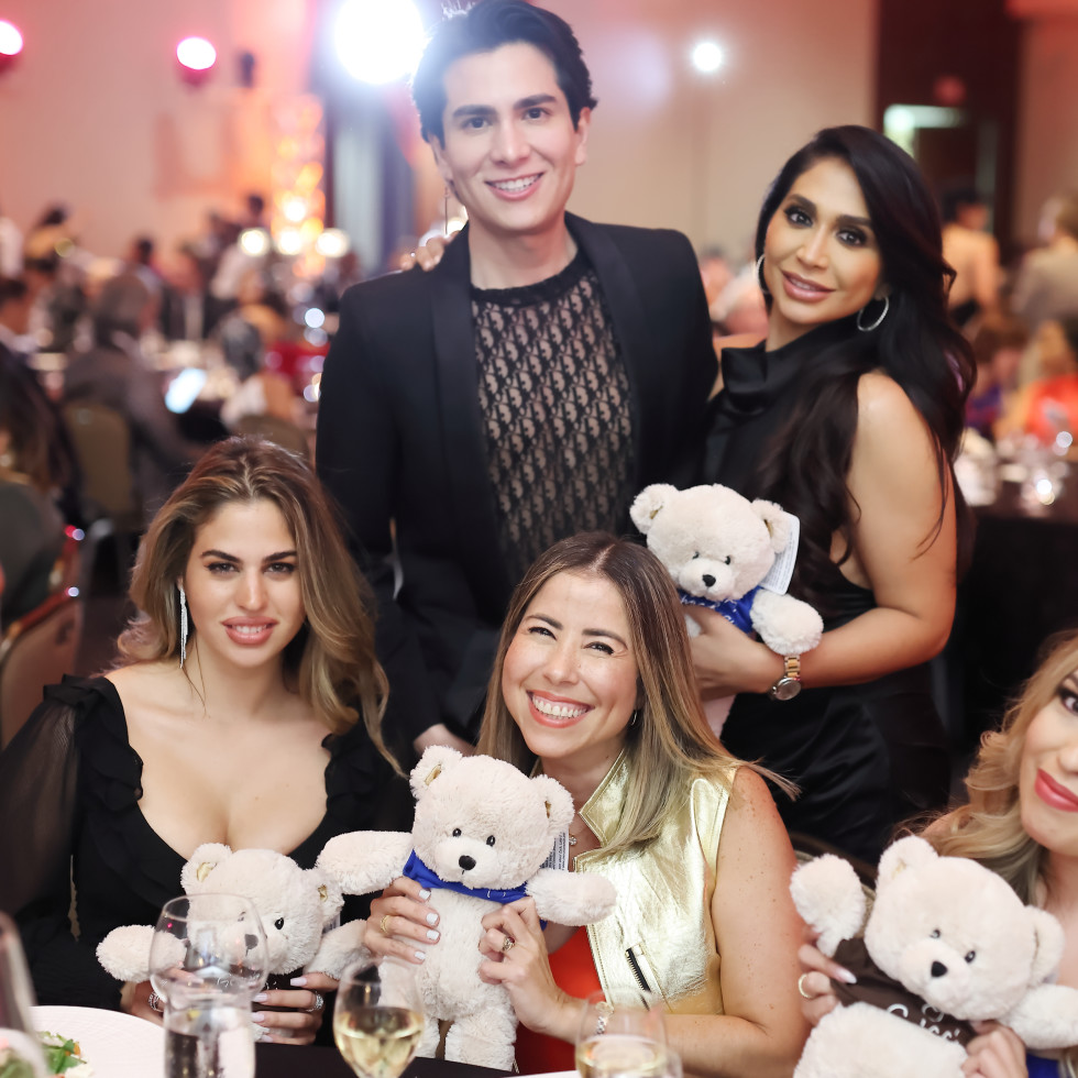 Operation Smile Gala 2021 Yasmine Kateb (left), Angel Woolsey, and party guests