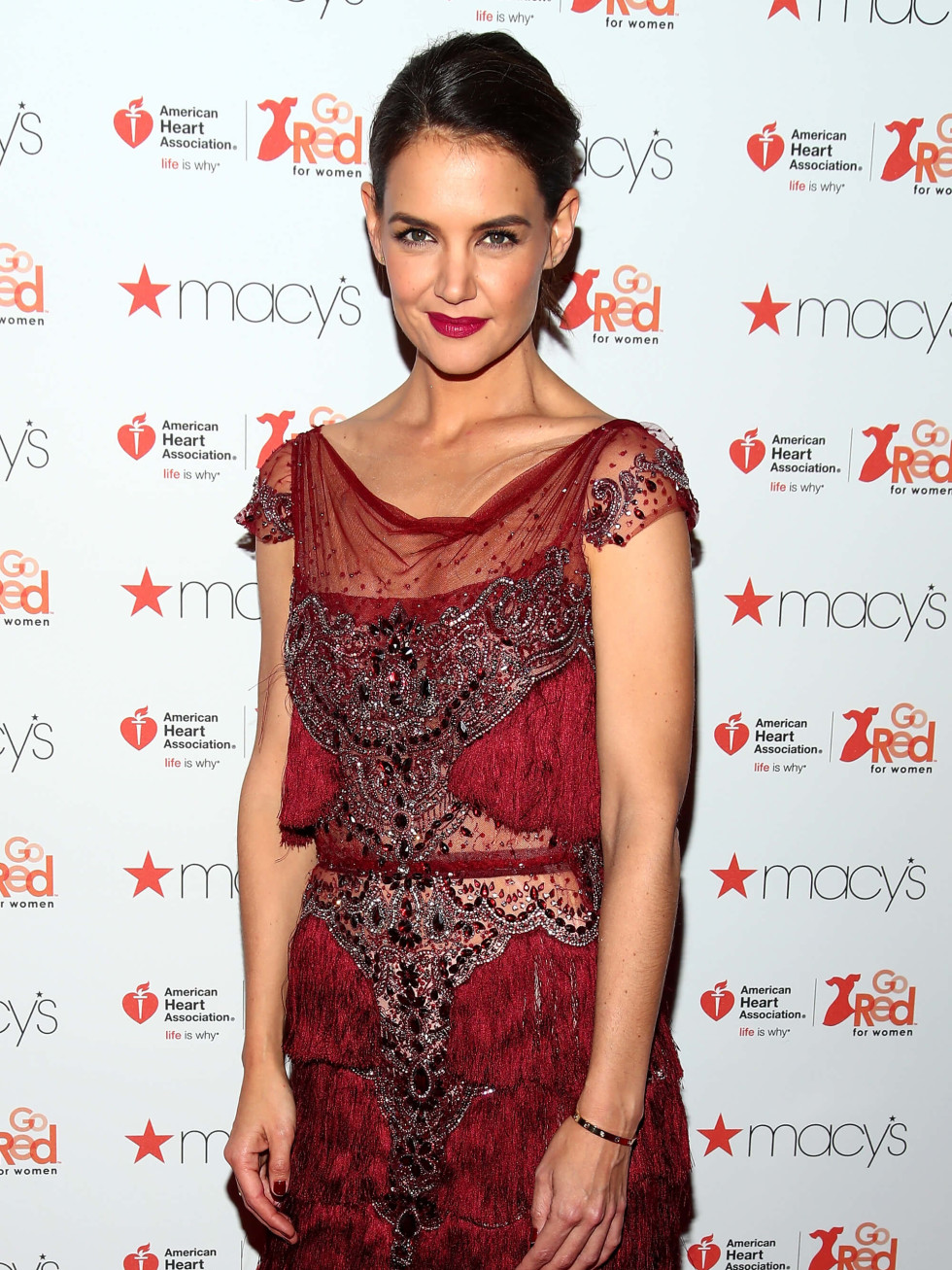 Actress Katie Holmes attends the American Heart Association's Go Red For Women Red Dress Collection 2017 p