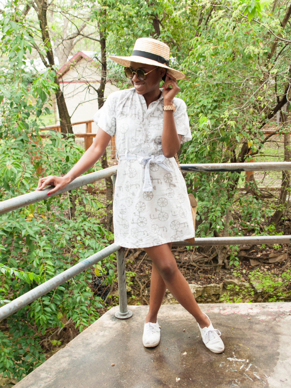Model wears white dress and white tennis shoes in austin, texas