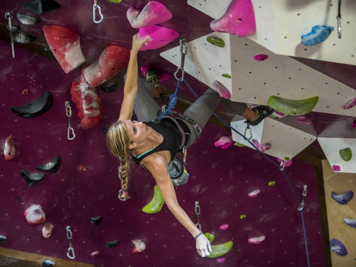 Woman on a climbing wall at Crux Climbing