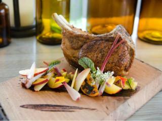 Tomahawk pork chop at Proof + Pantry in Dallas