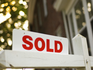 Home for sale sold sign