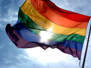 News_Rainbow flag_gay pride_sky_clouds
