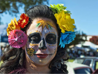 woman in Dia de Los Muertos skull face paint