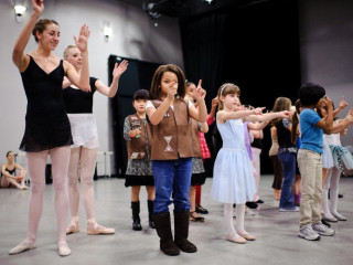 Ballet dancer leading class at Ballet Austin family dance workshop