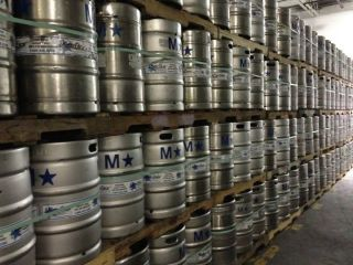 stacks of beer kegs