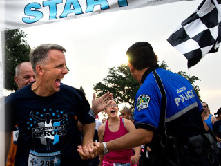runners and police at Run with the Heroes 5k fundraiser