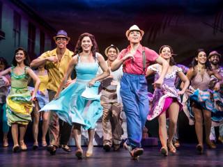 Christie Prades, Adriel Flete, and Company of On Your Feet tour