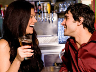 Couple on a date drinking beer