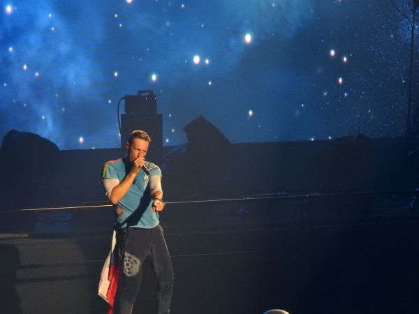 Chris Martin on stage at Coldplay concert