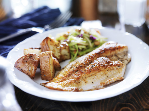 Fish on a plate with potatoes and slaw