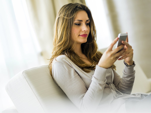 Hot girl looking at her phone